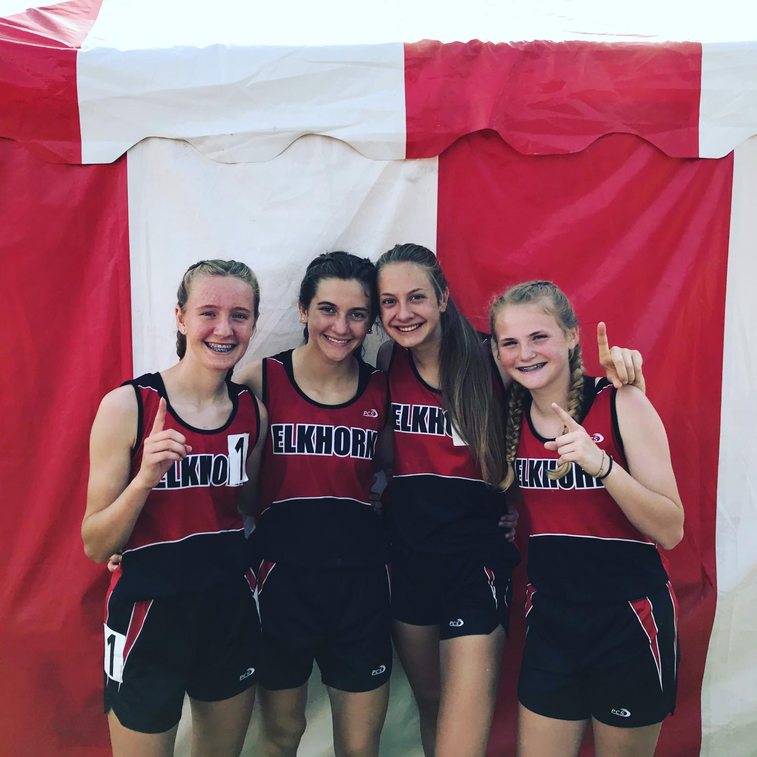 Members of the girls 3200 meter relay celebrate their win at the 2018 NSAA State Track Championships. From left: Taylor Kimnach, Abby Metschke, Grace Lamski, Maddie Yardley.