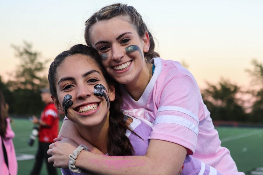 Seniors+Allyssa+Perotto+and+Julia+Labegaline+celebrate+the+senior+class+at+the+annual+Powder+Puff+football+game.+%23BeKind+activities+were+part+of+Homecoming+week+festivities.