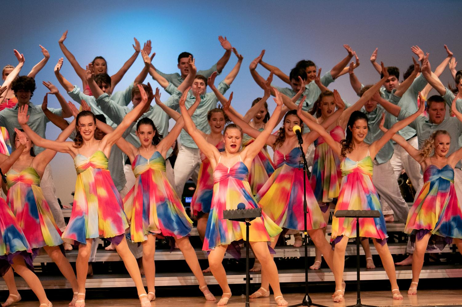 Excel dancing passionately after their costume change to light and flowy attire.