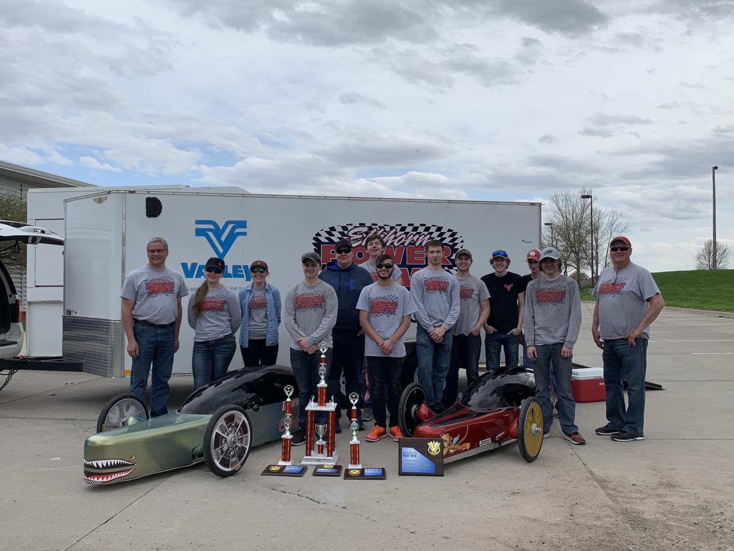 Members+of+the+Power+Drive+team+pose+with+their+cars+and+sponsors+after+securing+the+team%27s+4th+consecutive+championship.+The+team+is+a+co-op+with+Elkhorn+South.+