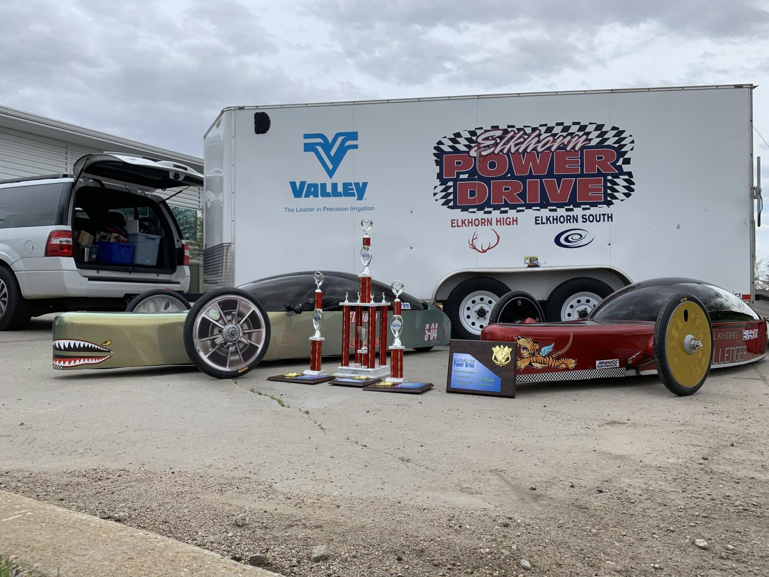 Elkhorn+Power+Drive+displays+their+trophies+and+cars+after+winning+a+4th+consecutive+state+championship.+The+team+designs%2C+builds+are+races+two+electric+vehicles.