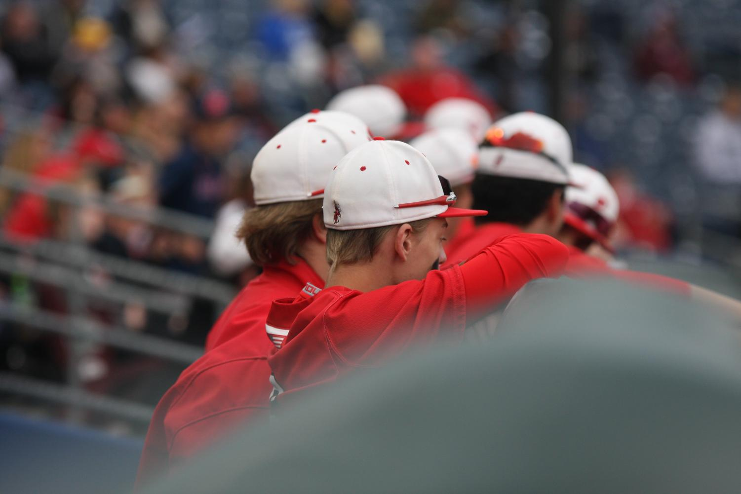 Elkhorn varsity boys baseball team watches the game from the dugout. Elkhorn lost the first round of state baseball on Saturday.