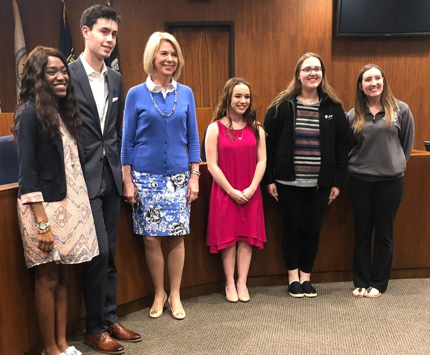Elkhorn Students Sam Lilly, Ashtyn Tridle, and Katie Swanson stand next to Omaha Mayor Jean Stothert and the mayor's facilitators Kelsey Dolinsky and Terri Armstrong. Dolinsky and Armstrong led the Mayor's group throughout the year.