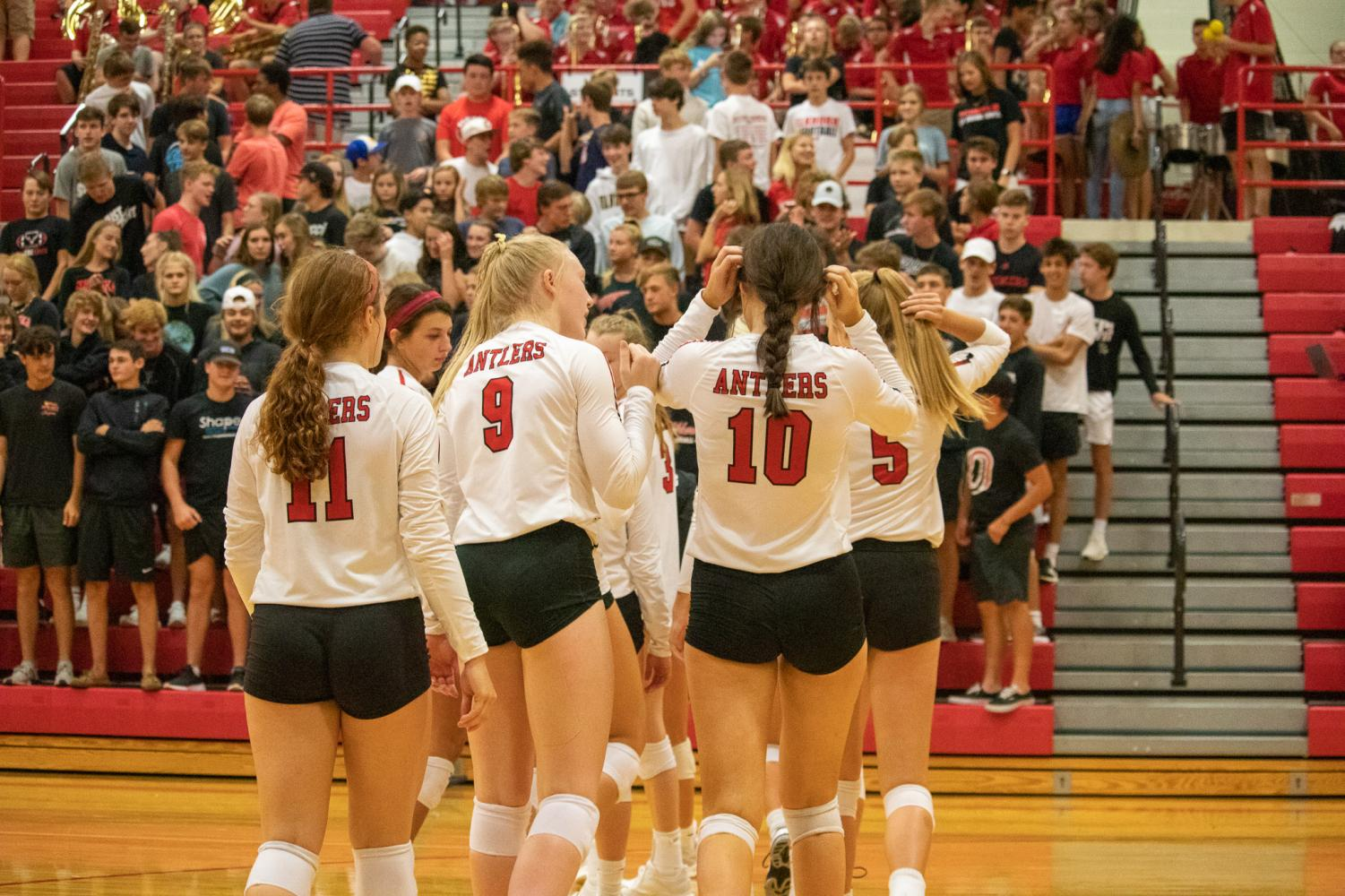 Antler+volleyball+players+walking+out+to+get+ready+for+the+National+Anthem.