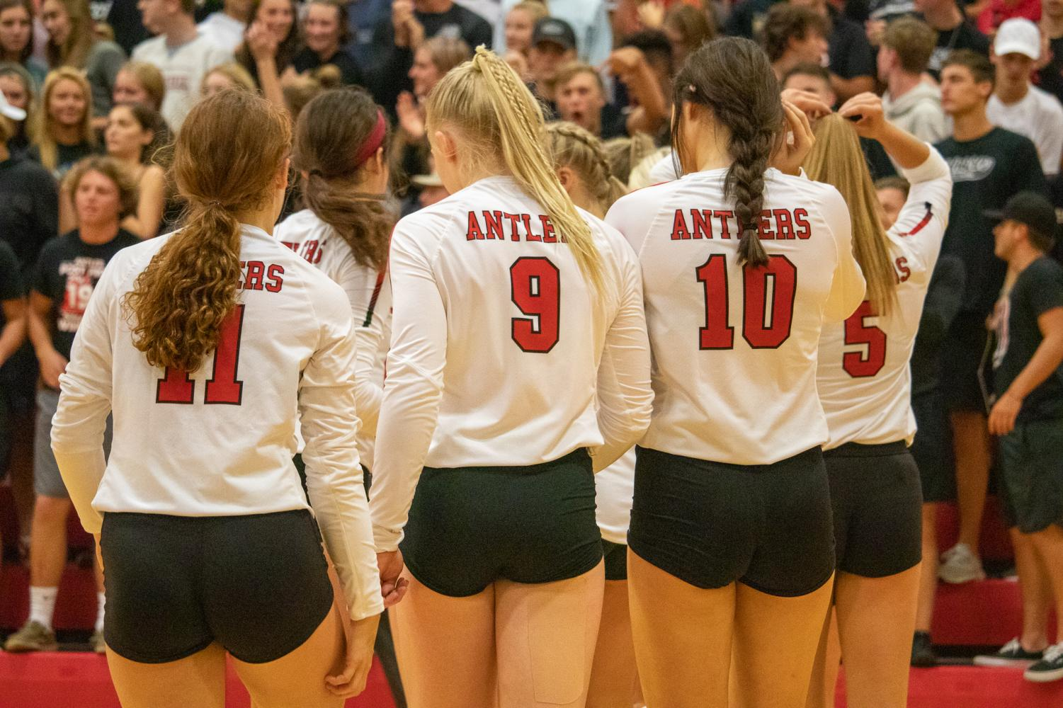 Antler+volleyball+players+walking+out+to+line+up+for+introductions.