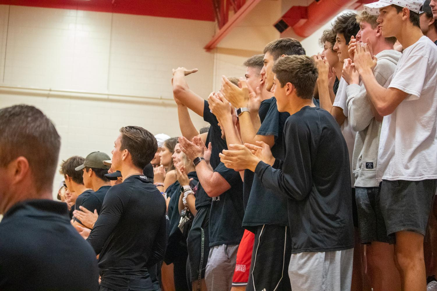 The+student+section+cheering+on+the+girls+showing+the+blackout+theme.