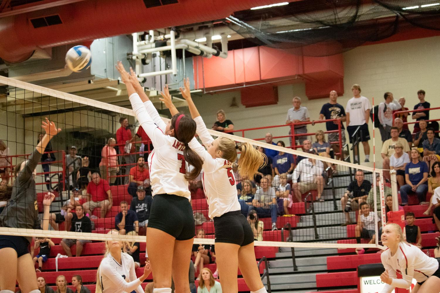 Junior+Abby+Wolfe+a+%287%29+and+Sophomore+Sydney+Raszler+%285%29+blocking+the+last+set+ball.