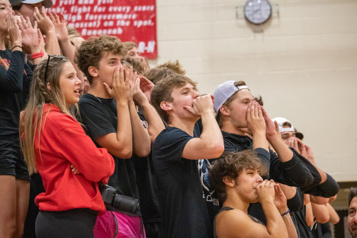 The+student+section+cheering+the+girls+on+and+showing+Elkhorn+South+which+side+is+rowdier.+