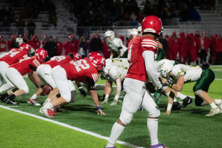 The Dragons defense sets up against the Antler offense right before the snap. The Antlers made a solid defensive stop in their territory at the beginning of the game. An early fumble gave Gretna an easy touchdown and put Elkhorn in a hold that they never crawled out of.