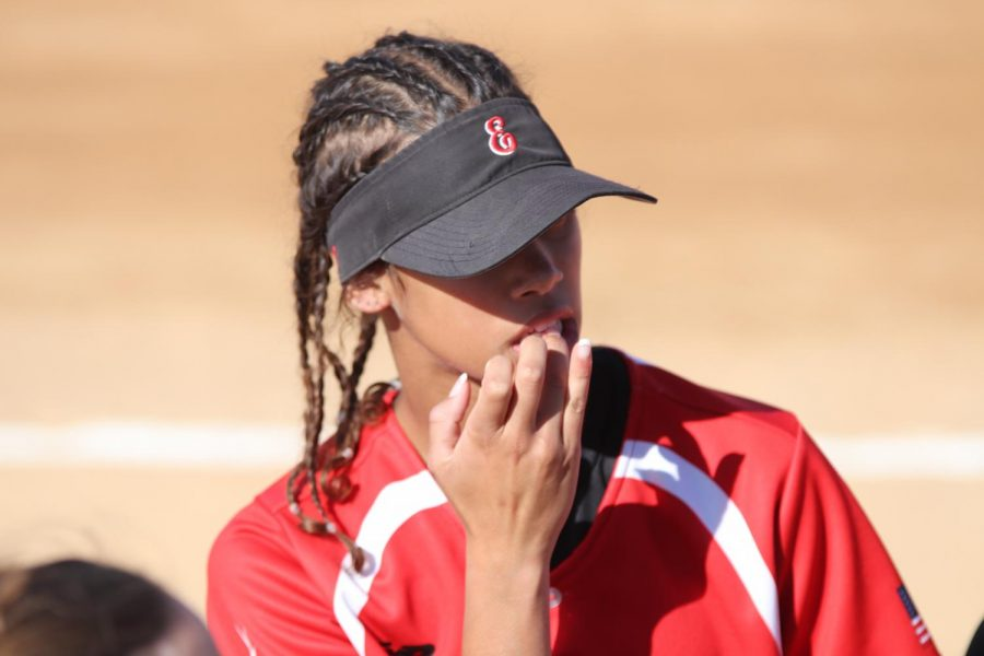 Junior Ariyana Crafton bites her nails before the first game begins. She was nervous before the first inning.