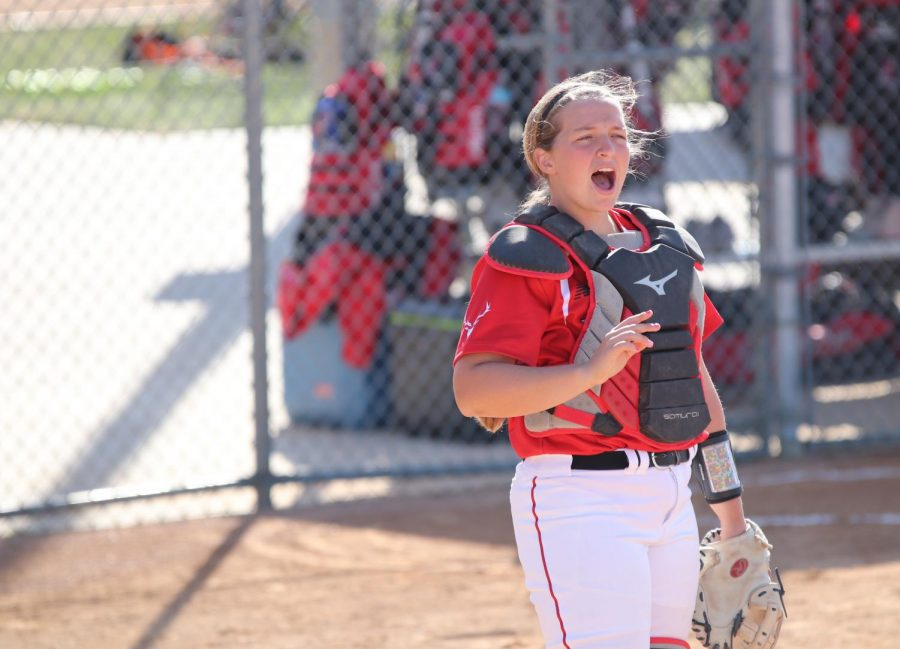 Paige Roessner yells to a teammate while the team warms up. She did this every time a new pitch was about to be thrown.