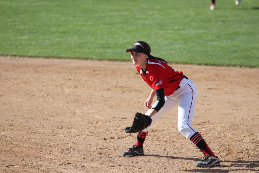 Payton Cooley prepares to catch a ball on the field. She was ready to go as the pitcher threw her pitch.