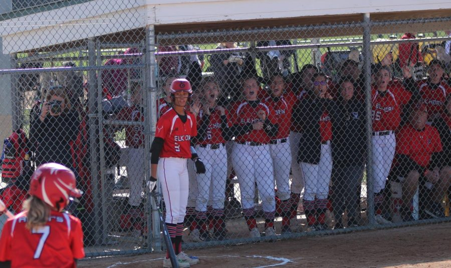 The Antlers cheer on their teammate as they step up to bat. They had cheers and songs that they sang to hype each other up.