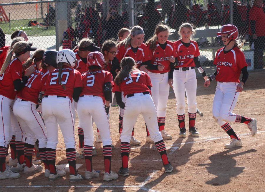 The Antlers gather around home plate to usher a teammate to home plate. They did this whenever a player was running home.