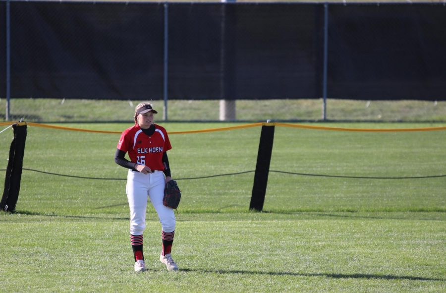 Junior Jaycee Schutte waits in the outfield for the pitcher to throw the ball. She was ready to catch any fly balls that came back to her.