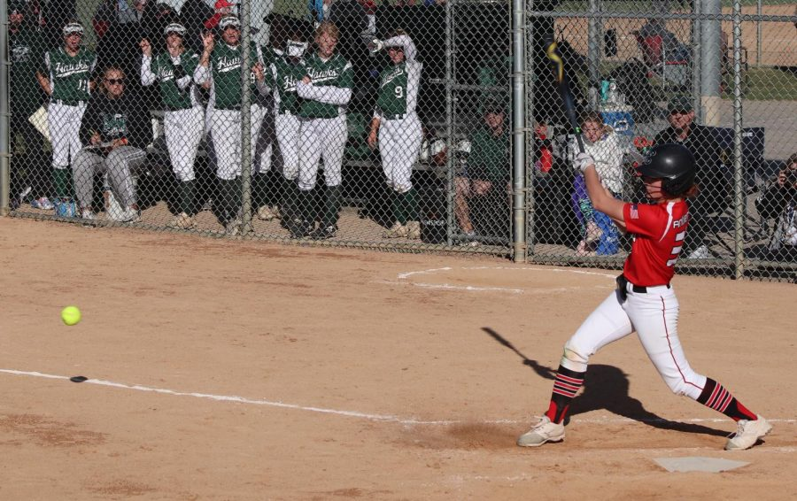 Camryn Cramer hits a pitch. Her team cheered when they heard the crack of the bat.