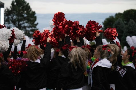 The Elkhorn Cheerleaders hype themselves up before cheering for the Antlers as they play the Bulldogs.
