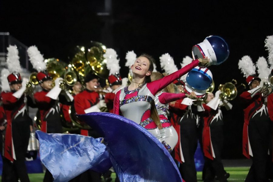 Sophomore Anna Crissman performs in the band halftime show, Moonshot.