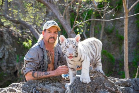 Joe Exotic pictured with one of the tiger cubs at his Oklahoma zoo.