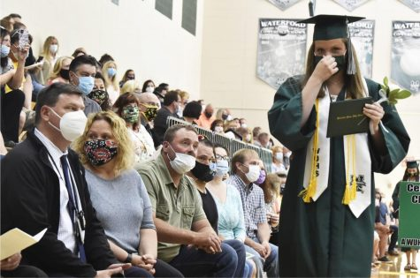 A high school in Connecticut holds an in-person graduation ceremony amdist a global pandemic.