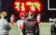 Aiden talks to the trainer on the sidelines.