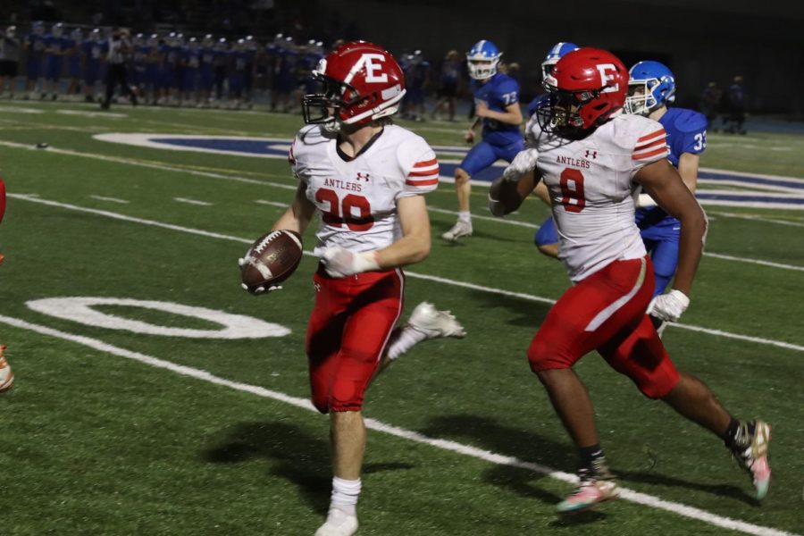 Junior Mikey Hart runs the ball ouut of bounds after a big gain on the kickoff.