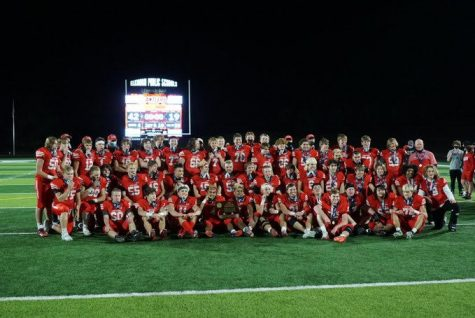 The football team celebrates their state title with a team photo.