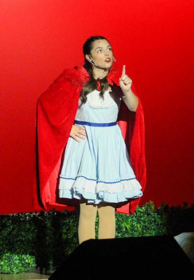 Little Red Riding Hood sings.