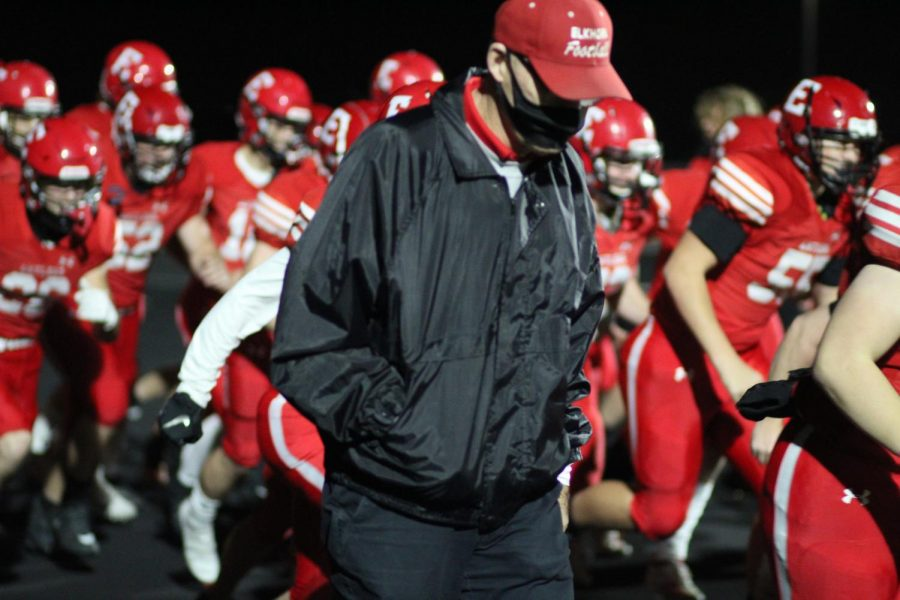 Coach Mark Wortman walks with the team to take the field for the state championship game. The Antlers beat Aurora 42-19 in the final game of Wortman
