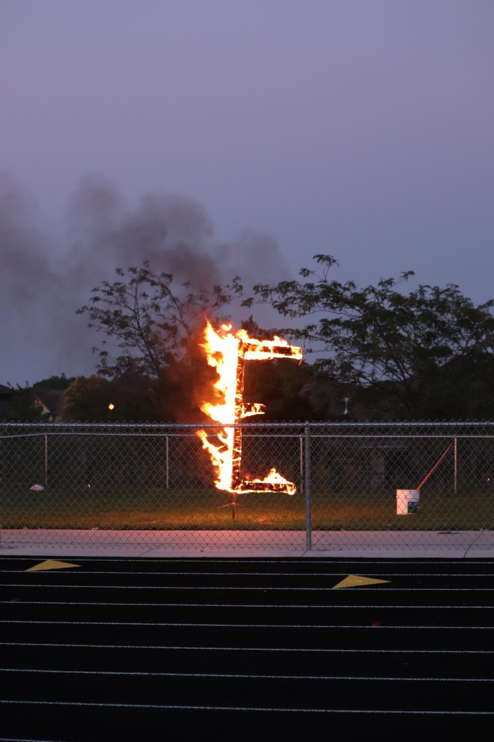The E was burnt behind the fence this year.